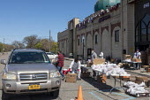 Dearborn, Michigan USA Coronavirus pandemic, queuing cars waiting for food for children distributed at the American Moslem Society mosque - Jim West - 2020,2020s,America,american,americans,BAME,BAMEs,Belief,Black,BME,bmes,CAR,cars,charitable,charity,CHILD,CHILDHOOD,children,conviction,coronavirus,covid-19,Dearborn,disease,DISEASES,diversity,DOWNTURN