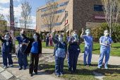 Detroit, Michigan USA Coronavirus Pandemic. Parade of first responders honored health care workers who lined the sidewalk at Ascension St. John Hospital - Jim West - 1st,2020,2020s,activist,activists,adult,adults,against,America,american,americans,Ascension St John,CAMPAIGNING,CAMPAIGNS,coronavirus,covid-19,DEMONSTRATING,Demonstration,Detroit,disease,DISEASES,doct