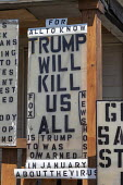 Detroit, Michigan, USA. Coronavirus Pandemic signs adorn the home of Mike Forbes in a poor neighborhood that has been hard hit by the pandemic. Trump will kill us all - Jim West - 06-05-2020