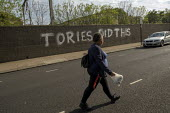 Coronavirus Pandemic. Tories Did This graffiti, East London blaiming the Conservatives for the crisis - Jess Hurd - 2020,2020s,BAME,BAMEs,Black,BME,bmes,cities,City,CONSERVATIVE,Conservative Party,conservatives,coronavirus,covid-19,crisis,disease,DISEASES,diversity,East London,epidemic,ethnic,ethnicity,FEMALE,Graff