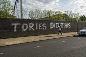 Coronavirus Pandemic. Tories Did This graffiti, East London blaiming the Conservatives for the crisis - Jess Hurd - 2020,2020s,BAME,BAMEs,Black,BME,bmes,cities,City,CONSERVATIVE,Conservative Party,conservatives,coronavirus,covid-19,crisis,disease,DISEASES,diversity,East London,epidemic,ethnic,ethnicity,Graffiti,Lon