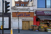 Coronavirus Pandemic. Closed and boarded up Cafe Bar, Golders Green, London. - Philip Wolmuth - 05-05-2020