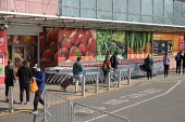 Coronavirus Pandemic. Queue outside Sainsbury's supermarket, Finchley Road, London - Philip Wolmuth - 06-05-2020