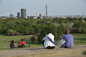 Coronavirus Pandemic. Primrose Hill, London, where lockdown rules regarding social distancing, sunbathing and picnicing are not consistently observed. - Philip Wolmuth - 2020,2020s,cities,City,cityscape,cityscapes,coronavirus,covid-19,disease,DISEASES,epidemic,exercise,exercises,FEMALE,Leisure,LFL,LIFE,Lifestyle,lockdown,London,male,man,men,outdoor,outdoors,outside,pa