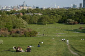Coronavirus Pandemic. Primrose Hill, London, where lockdown rules regarding social distancing, sunbathing and picnicing are not consistently observed. - Philip Wolmuth - 2020,2020s,cities,City,cityscape,cityscapes,coronavirus,covid-19,disease,DISEASES,epidemic,exercise,exercises,Leisure,LFL,LIFE,Lifestyle,lockdown,London,male,man,men,outdoor,outdoors,outside,pandemic,