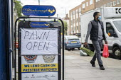 Coronavirus Pandemic. Pawnshop open, lockdown restrictions relaxed, Bethnal Green, East London - Jess Hurd - 2020,2020s,BAME,BAMEs,Bethnal Green,Black,BME,bmes,cities,City,coronavirus,covid-19,debt,disease,DISEASES,diversity,East London,EBF,Economic,Economy,epidemic,ethnic,ethnicity,excluded,exclusion,face m