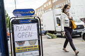 Coronavirus Pandemic. Pawnshop open, lockdown restrictions relaxed, Bethnal Green, East London - Jess Hurd - 12-05-2020