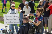 Lansing, Michigan US Coronavirus Pandemic. Barbers giving free haircuts on the lawn of the Michigan State Capitol in protest against emergency orders which keep many businesses closed. The protest, ca... - Jim West - 2020,2020s,activist,activists,against,America,american,americans,barber,CAMPAIGNING,CAMPAIGNS,civil disobedience,Conservative,conservatives,coronavirus,covid-19,cut,cutting,DEMONSTRATING,Demonstration