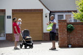 Coronavirus Pandemic. Neighbours talking at a safe distance, Stratford Upon Avon - John Harris - 18-05-2020