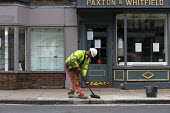 Coronavirus Pandemic. Worker repairing pavement, closed shops, Stratford Upon Avon - John Harris - 15-05-2020