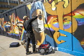 Coronavirus Pandemic: NHS heroes graffiti artist Owe1 painting a mural depicting health worker in PPE, Shoreditch, East London. - Jess Hurd - 2020,2020s,ACE,art,artist,artists,arts,artwork,artworks,coronavirus,covid-19,culture,disease,DISEASES,East London,epidemic,frontline,Graffiti,graffitti,health,Health Worker,health workers,heros,Key wo