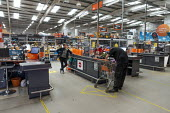 Coronavirus Pandemic: Social distancing, shopworker scanning purchases for a customerB&Q store, Stratford upon Avon - John Harris - 23-05-2020