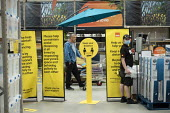 Coronavirus Pandemic: Social distancing and shopworker, B&Q store, Stratford upon Avon - John Harris - 23-05-2020
