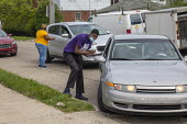 Detroit, Michigan, USA Coronavirus pandemic. Volunteers registering people to vote on their arriving for free food distribution - Jim West - 23-05-2020