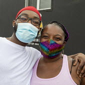 Detroit, Michigan USA Volunteers wearing face masks pose for a photograph. Distributing free food in a low income neighborhood during the coronavirus pandemic - Jim West - 23-05-2020