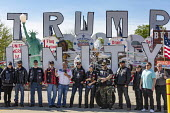 Lansing, Michigan, USA Biker Trump supporters pose for a photograph in front of the Trump Unity Bridge. They had rallied outside a barbershop next door that defied Michigan Gov. Gretchen Whitmer's ord... - Jim West - 2020,2020s,America,american,americans,bike,biker,bikers,Bikers for Trump,campaign,CAMPAIGNING,CAMPAIGNS,cities,City,DEMOCRACY,Donald Trump,election,ELECTIONS,Far Right,Far Right,fascism,Fascist,Fascis