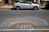 Coronavirus pandemic, Childs chalk drawing of a rainbow in appreciation for the NHS , Wandsworth, London - Duncan Phillips - 2020,2020s,activist,activists,against,CAMPAIGN,campaigner,campaigners,CAMPAIGNING,CAMPAIGNS,chalk,child,CHILDHOOD,children,Childs,cities,City,color,colorful,colorfull,colors,colour,colourful,colours,D