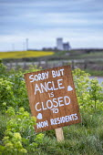 Coronavirus Pandemic. Sign asking non residents to stay away, Angle, Pembrokeshire, Wales - Paul Box - 07-04-2020