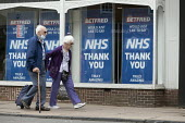 Elderly couple walking pas NHS Thank You signs, Stratford Upon Avon - John Harris - 16-06-2020