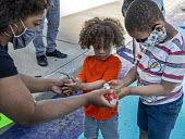 Detroit, Michigan USA Mother rubbing her children's hands with sanitizer, Black Disabled Lives Matter protest - Jim West - 15-06-2020