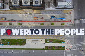 Detroit, Michigan USA POWER TO THE PEOPLE painted by youth on Woodward Avenue with the support of the city of Detroit. The project comes amid weeks of Black Lives Matter protests over the murder of Ge... - Jim West - 18-06-2020