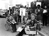 Disabled Anti Apartheid Movement protest, International Stoke Mandeville Games, forerunner of the Paralympics, opening day July 1981. Calling for South Africa to be barred from the Games. The followin... - Tessa Howland - 01-07-1982