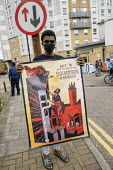 Focus E15 Mothers Chain of Power protest the scandal of Newham Council leaving 400 empty homes at the Carpenters Estate while those living at the Brimstone House hostel and many others need safe housi... - Jess Hurd - 27-06-2020