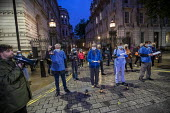Sixty NHS staff and campaigners carrying a lantern each to represent the 60,000 deaths from Coronavirus. Reading the names of NHS staff who have died from coronavirus outside Downing Street. Organised... - Jess Hurd - 03-07-2020