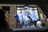 Coronavirus Pandemic. Woman being tested, drive thru testing Station, London. Mylocum Agency Nurse - Duncan Phillips - 06-07-2020