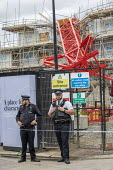Police, Bow crane collapse, Watts Grove construction site, killing one person killed and homes destroyed. Tower Hamlets, East London - Jess Hurd - 09-07-2020