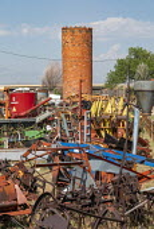 Colorado, USA, old brick grain silo and rusting farm equipment - Jim West - 03-07-2020