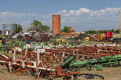 Colorado, USA, old brick grain silo and rusting farm equipment - Jim West - 03-07-2020