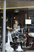 Hairdresser opening, child getting a haircut as lockdown restrictions are released - John Harris - 04-07-2020