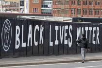 Man walking past huge Black Lives Matter graffiti, Digbeth, Birmingham - John Harris - 22-07-2020