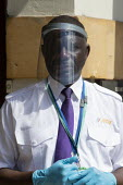 Marsk up Friday, Security guard with a face shield visor, checking visitors, District Council Offices - John Harris - 24-07-2020