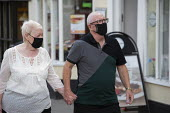 Mask up Friday, Shoppers wearing masks in the street, Stratford Upon Avon. Elderly couple holding hands - John Harris - 24-07-2020