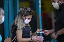 Mask up Friday, Shoppers wearing masks in the street outside Poundland, Stratford Upon Avon - John Harris - 24-07-2020
