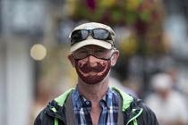 Mask up Friday, tourist wearing novelty mask in the street, Stratford Upon Avon - John Harris - 24-07-2020