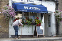 Elderly man with stick and face mask shopping at H C Lewis Butchers, Kineton, Warwickshire - John Harris - 01-08-2020