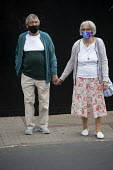 Elderly couple with face masks holding hands, Stratford Upon Avon - John Harris - 29-07-2020
