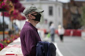 Elderly shopper with black face mask waiting outside Marks & Spencer, Stratford Upon Avon - John Harris - 29-07-2020
