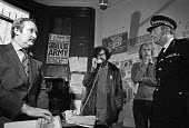 Police and bailiffs negotiating with Piers Corbyn 1975 representing the squatters, Elgin Avenue squat, West London - Martin Mayer - 14-10-1975
