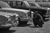 Sotheby's auction sale, Mentmore Towers 1977. A chauffeur buffing up a Rolls Royce while the rich and famous bid for the contents contents of the stately home belonging to the 7th Earl of Rosebery - Martin Mayer - 18-05-1977