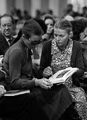 Sotheby's auction sale, Mentmore Towers 1977. Young ladies perusing the catalogue at the sale of the contents of the stately home belonging to the 7th Earl of Rosebery. Mentmore was sold to the Mahari... - Martin Mayer - 18-05-1977