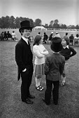 Eton College, Berkshire, 1977 sense of entitlement starts young. Boys in the distinctive Eton uniform with their sisters, inter-house cricket match on Agar���s Plough, 4th June celebration to mark the... - Martin Mayer - 04-06-1977