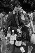 Eton College, Berkshire, 1977 an old etonian with his girlfriend. Pimms, Moet and Marlborough, the essential ingredients for a perfect 4th June celebration to mark the birthday of King George III at t... - Martin Mayer - 04-06-1977