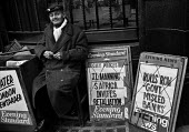 City of London 1971 newspaper vendor selling Evening Standard and Evening Newspapers - Martin Mayer - 26-02-1971