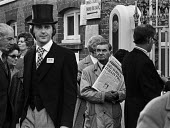 Royal Ascot races 1975 striking stable lads picketing. Bad news from Italy for a racegoer arriving in top hat and morning dress, newspaper seller with Evening Standard headline Red Surge in Italian Po... - Martin Mayer - 16-06-1975