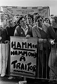 Sacked Wapping printers lobby TUC Congress, 1986, London. Placard calling Eric Hammond (EETPU) a traitor for doing a deal with the Murdoch News International to break the print unions - NLA - 01-09-1986