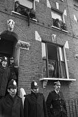 Squatters watching the police below, 1976, Kenninton, South London - NLA - 10-12-1976